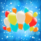 Background with stars and balloons. Blue bokeh background with stars and balloons Royalty Free Stock Images