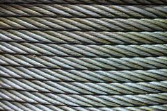 Background with a steel cable. Stock Photos