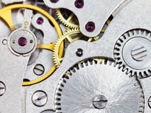 Background from steel clockwork of vintage watch Royalty Free Stock Images