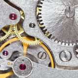 Background from steel movement of vintage clock Stock Image