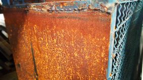 The background of the steel plate has orange rust. stock image