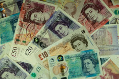 Background of sterling banknotes scattered. Background of UK sterling banknotes scattered Royalty Free Stock Image