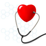 Background with stethoscope against a heart. Royalty Free Stock Photo