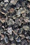 Background stone. Metallic net fence Royalty Free Stock Images