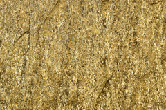Background of stone with gold flecks. Stone rock with gold particles.  royalty free stock images