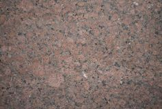 Background stone granite with black, pink and brown inclusions. Background natural stone granite with black, pink and brown inclusions Royalty Free Stock Photo