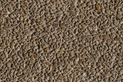 Background of stone and sand. Background of small brown rocks and sand Stock Photo