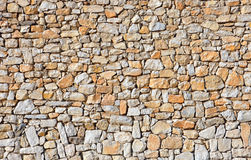 Background stone wall. Yellow and gray background stone wall royalty free stock images