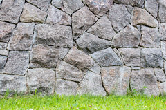 Background of a stone wall  in a lawn Stock Images