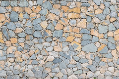 Background stone wall texture. Dry wall with stones arranged irregularly Royalty Free Stock Image