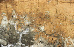 Background of stone wall texture. ocher Old cracked plaster Stock Photos