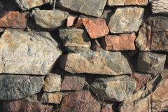 Background texture. Old stone wall lit by the sun royalty free stock photos