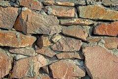 Background texture. Old stone wall lit by the sun stock images