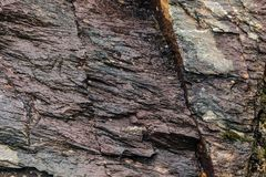 Background of stone wall texture rough rock surface Stock Image