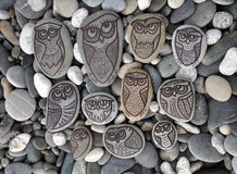 Background with stones  with painted decor owls Stock Photography