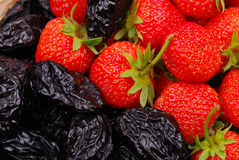 Background from strawberry and prune Stock Photography