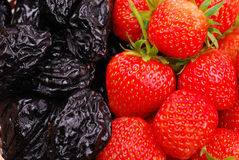 Background from strawberry and prune Stock Photo