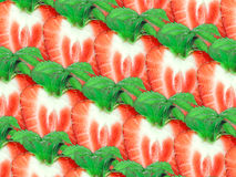 Background of strawberry slices and green leaf Stock Image