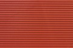 Background striped red metal profile. Texture of painted red metal surface. Royalty Free Stock Photos