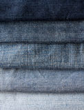 Background from strips of blue jeans of different shades and bri Stock Photography