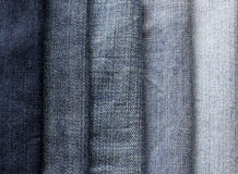 Background from strips of blue jeans of different shades and bri Royalty Free Stock Photo