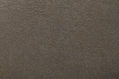 Background and structure of fine leather. Macro picture of fine leather structure in lihgt brown Royalty Free Stock Photography