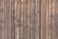 Background in style a rustic from old rough wooden unpainted boards. Background in style a rustic from old rough vertical wooden unpainted boards Royalty Free Stock Image