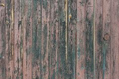 Background in style a rustic from old bare wooden painted boards. Background in style a rustic from old vertical bare wooden painted boards royalty free stock photo