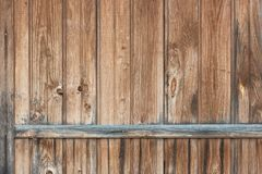 Background in style a rustic from old vertical wooden unpainted boards. With a horizontal crossbeam royalty free stock image