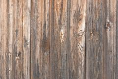 Background in style a rustic from old wooden unpainted boards with knots. Background in style a rustic from old vertical wooden unpainted boards with knots stock photos