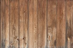 Background in style a rustic from old wooden unpainted boards. Background in style a rustic from old vertical wooden unpainted boards Stock Image