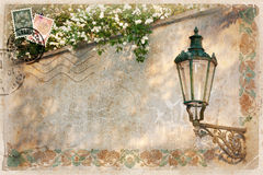 Background, stylized as vintage postcard. With street lamp and white lilacs. There's space for your text Royalty Free Stock Photos