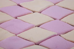 Background of sugar coated marshmallow candy. In pink and yellow Royalty Free Stock Image