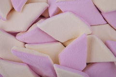 Background of sugar coated marshmallow candy. In pink and yellow Royalty Free Stock Photo