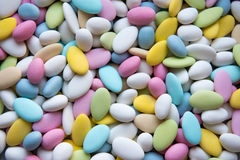Background of sugared almonds color blue, rose, green, yellow, beige and white. Royalty Free Stock Photo