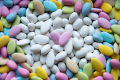 Background of sugared almonds color blue, rose, green, yellow, beige and white. Royalty Free Stock Images