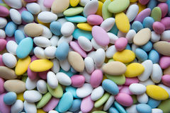 Background of sugared almonds color blue, rose, green, yellow, beige and white. Stock Photo