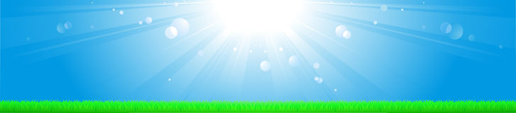 Background with sun, blue sky and grass Stock Photography