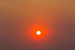 Background of Sun with red sky Stock Image