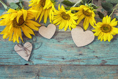 Background with sunflowers and hearts on old wood boards with pe Stock Photography