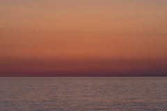 Background sunset. A delightful red background of a sunset over the sea Stock Images