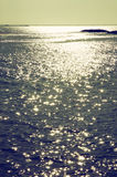 Background of sunset and sea waves. filtered image Royalty Free Stock Images