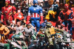 Background of superheroes action figures toys. Beautiful colourful wallpaper background image of cartoon and film action figures toys and dolls at a memorabilia stock photos