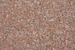 Background surface of compressed brown wood splinters and sawdust Royalty Free Stock Photo