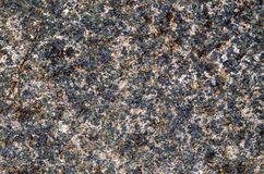 Background of the surface of the cut stone. Treated surface of granite. stock images