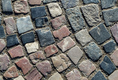 Background surface tile area round with uneven stone gray brick Royalty Free Stock Image