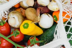 Background surface of various vegetables in white mesh net bag.  royalty free stock photo