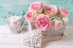 Background with sweet pink roses flowers  in wooden box, decorat Stock Photography