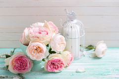 Background with sweet pink roses in vase and candle Royalty Free Stock Images