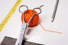 Background for tailor orange thread and sewing tools Royalty Free Stock Image